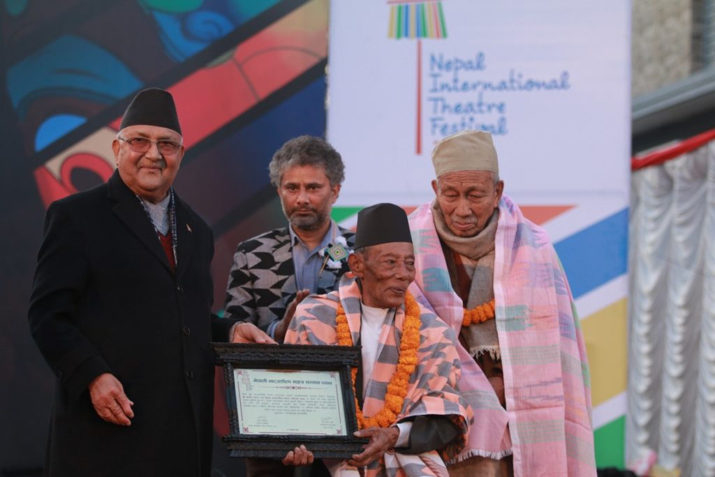 Primeminster Oli with the felicitated members